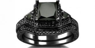 A 2.01 ct princess cut black diamond set in 14K blackened gold