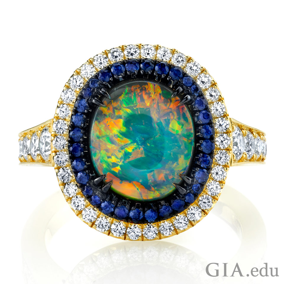October birthstone ring featuring black opal, sapphire and diamonds set in 18k yellow gold with black rhodium