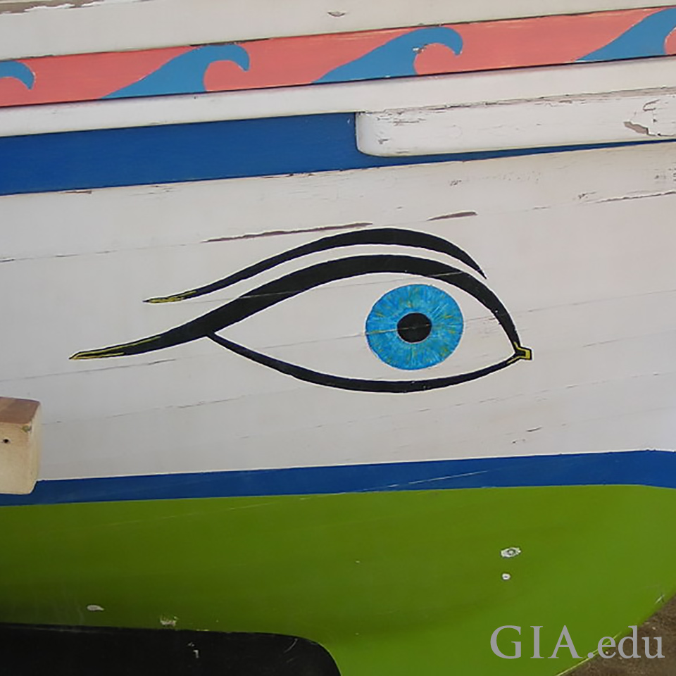 A boat in Malaga, Spain, with a blue eye painted on the side
