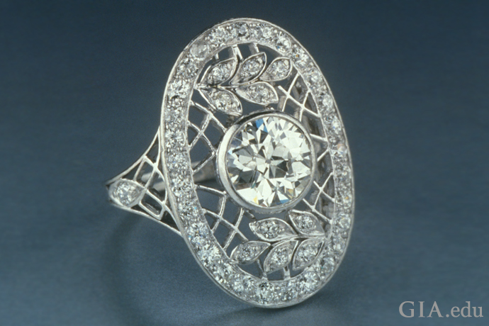 Lacework evokes a trellis in this Edwardian era ring