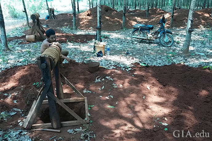 A miner digs for zircon in a forest in Cambodia.