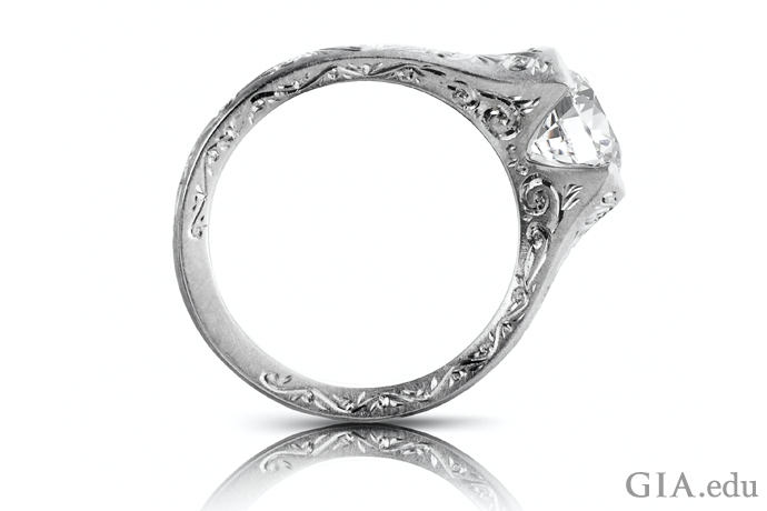 Contemporary engagement ring features numerous scrolls