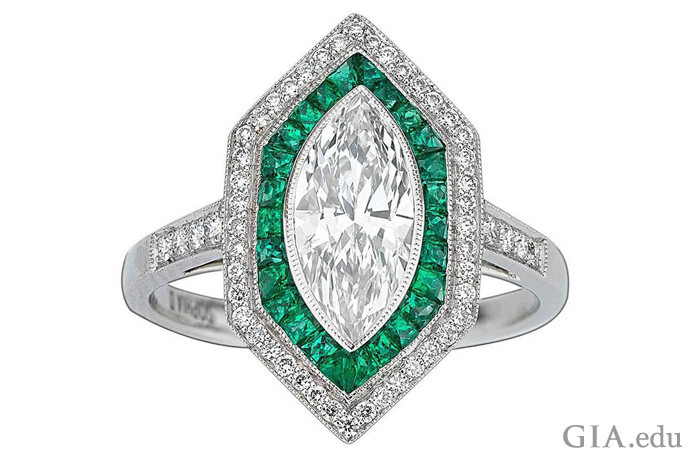 An Art Deco inspired ring with a 1.09 carat (ct) center stone, 0.35 carats of lush emeralds, and another 0.21 carats of diamonds