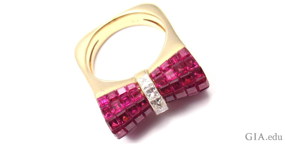 18K gold, ruby and diamond ring with an invisible bow setting