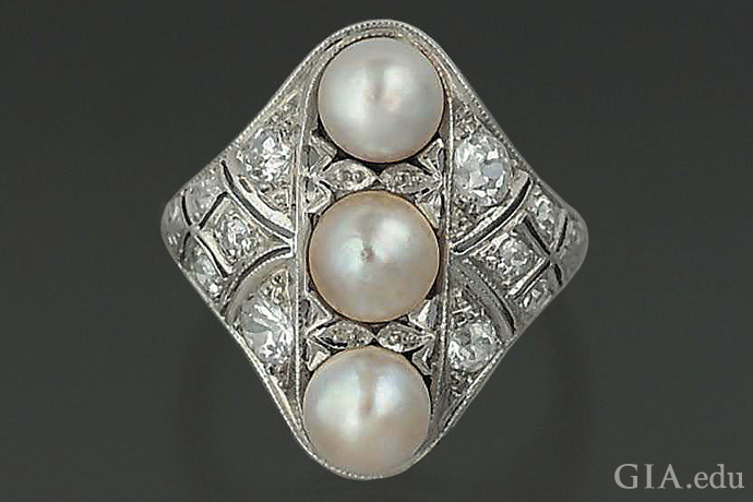 Three assembled cultured blister pearls and diamonds in this Edwardian ring