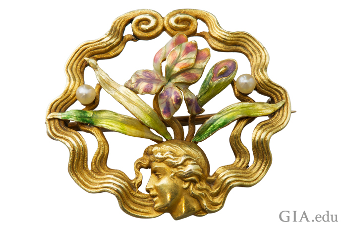 Art Nouveau pin with stylistic motifs.