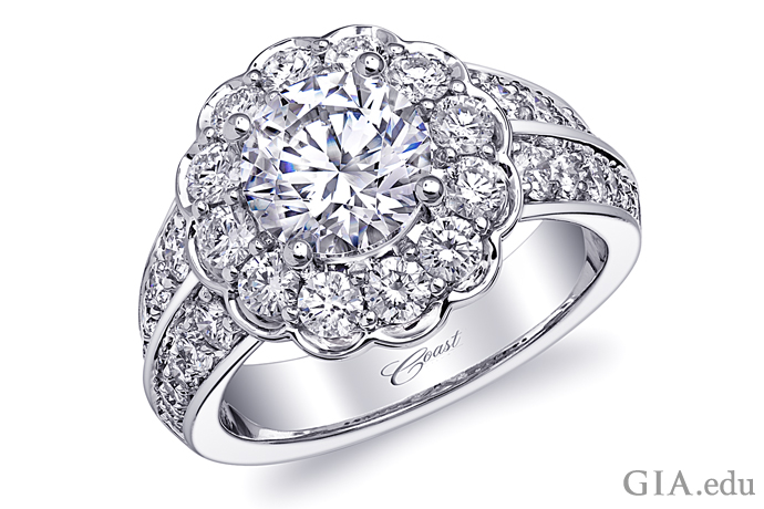 Platinum engagement ring, featuring a 1.50 ct CZ center stone surrounded by 1.40 carats of diamonds