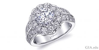 Platinum simulated diamond engagement ring, featuring a 1.50 ct CZ center stone surrounded by 1.40 carats of diamonds