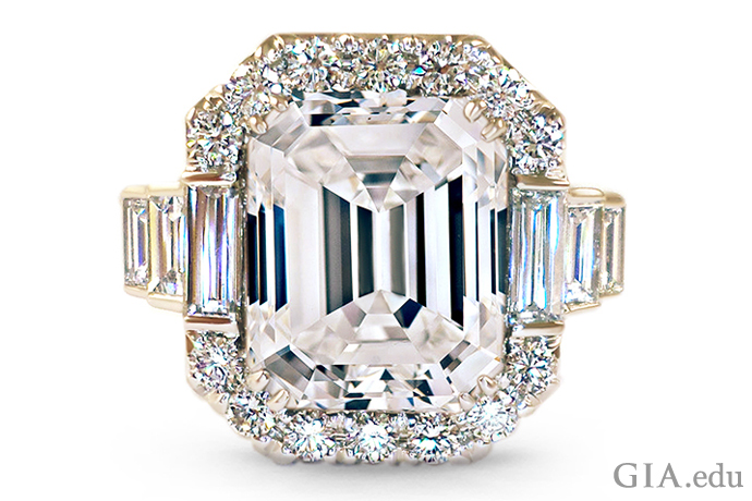 Ring featuring emerald-cut center diamond with baguette diamonds and round brilliants.