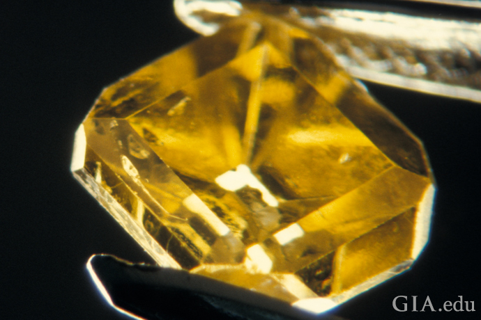 Brownish yellow synthetic diamond produced by General Electric.
