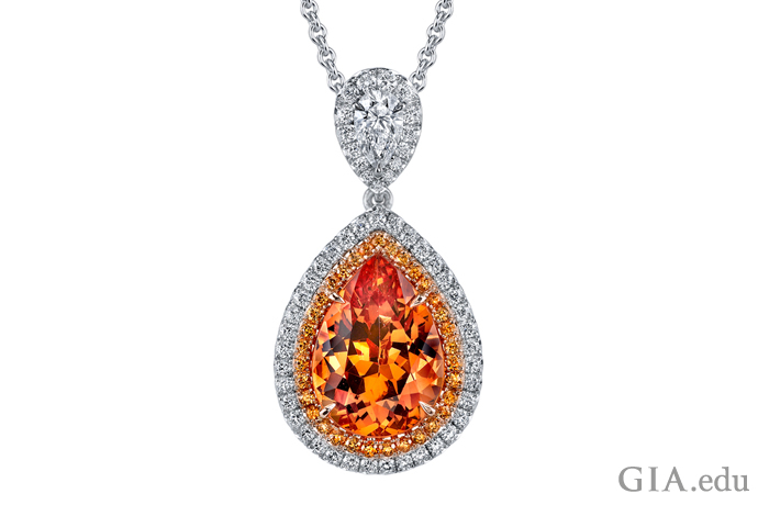 A 6.22 ct spessartine necklace is encircled with 0.40 ct of round diamonds set in platinum and 18K rose gold.