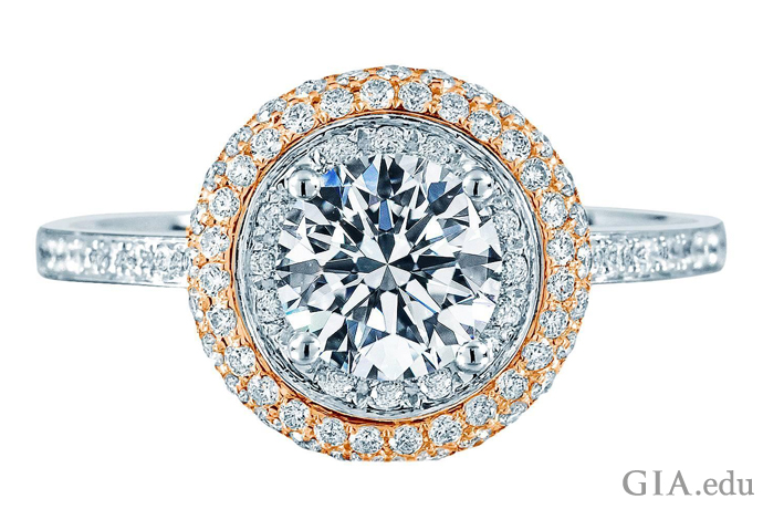 A pavé set diamond halo surrounds a center stone. The diamonds weigh a total of 1.46 carats.
