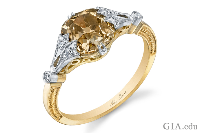 This yellow gold and platinum vintage-style engagement ring features a brown cushion-cut diamond.