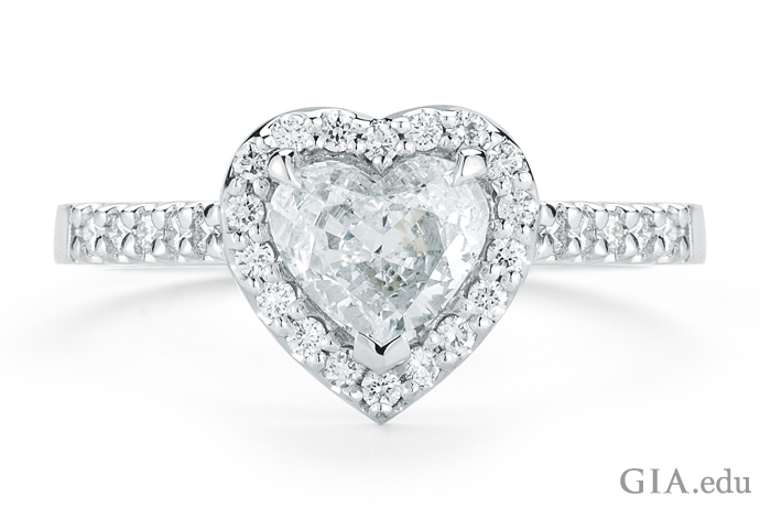 This beautiful platinum ring featuring a 1.25 ct heart-shaped diamond surrounded by pavé-set diamonds is sure to tell her you love her.