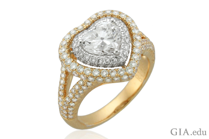 Surrounding a heart-shaped diamond by melee and placing it in a halo setting protects the point – and creates a stunner of a ring.