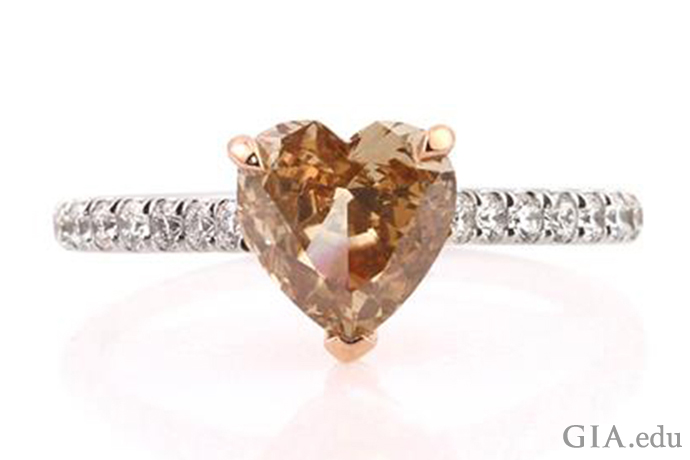 Simple yet stunning, this lovely fancy brown-yellow 1.03 ct heart-shaped diamond makes the perfect engagement ring.
