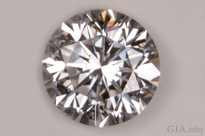 This diamond has a Good cut grade. Its bright-reflections aren't as sharp and there's more darkening around the girdle.