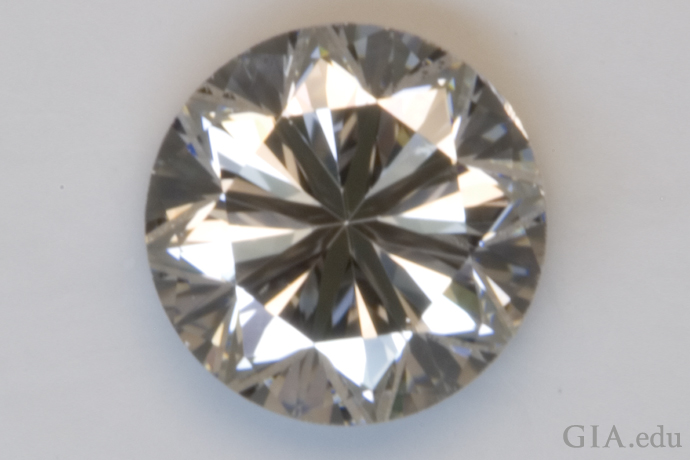 This diamond has a Poor cut grade. It has significantly more prominent dark areas; there's a much smaller bright area.