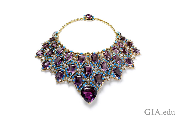 The Duchess of Windsor's bib-style necklace boasts 27 step-cut amethysts, one oval faceted amethyst, and a large heart-shaped amethyst in the front, as well as turquoise cabochons and brilliant cut diamonds, all suspended from a rope-like gold chain.