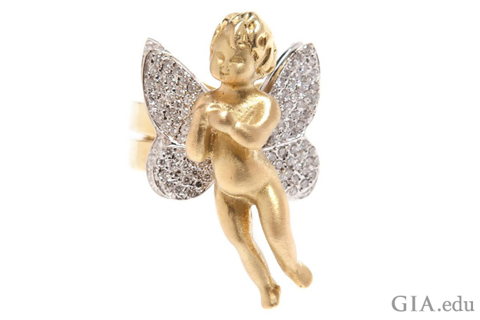Cupid is the adorable child in this 18K gold ring with wings studded with 1.90 carats of diamonds.