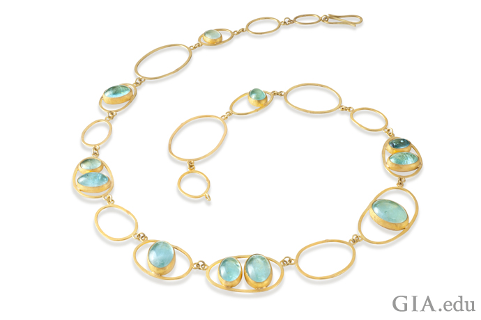 The aquamarine cabochons in this necklace look like drops of water from the Caribbean.