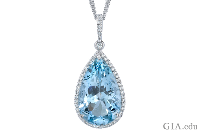 10.06 ct pear shaped aquamarine is surrounded by 72 round diamonds (0.35 carats) that are set in platinum.