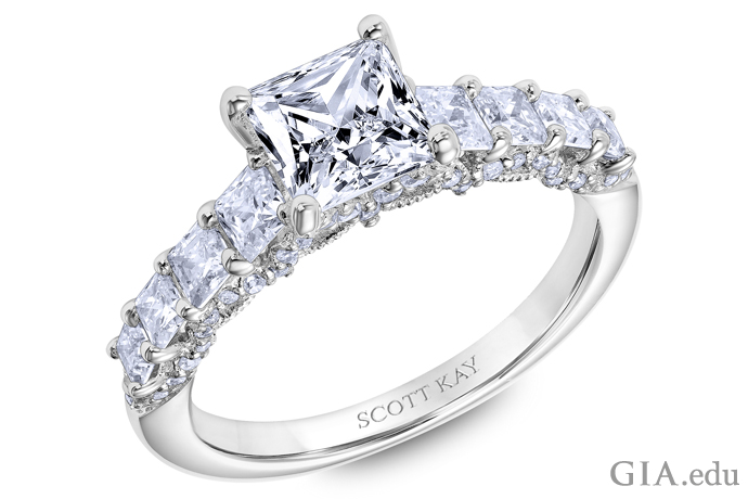 14K white gold princess cut diamond engagement ring with accent diamonds totaling 1.25 carats.