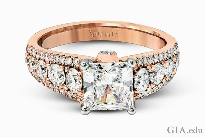 Rose gold princess cut engagement ring with round cut white diamonds