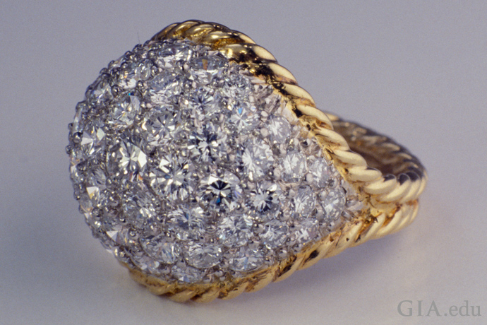 Cluster ring featuring 3.35 carats of diamonds in a pavé setting.