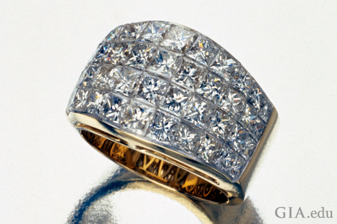 Yellow gold ring with diamonds in an invisible setting.