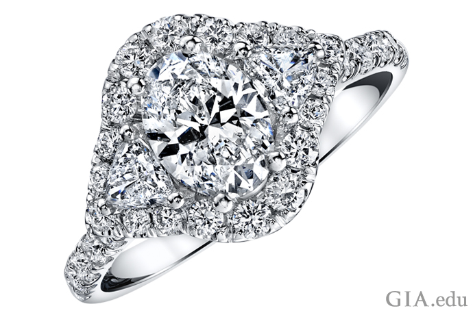 Engagement ring featuring a halo setting of melee diamonds.