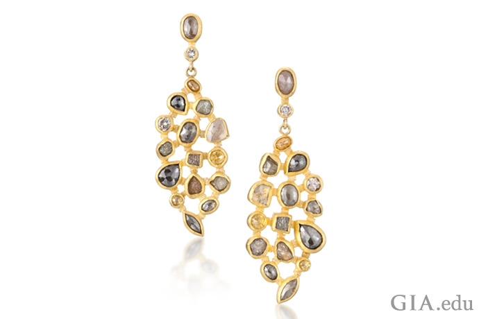 Yellow gold earrings set with rough diamonds.
