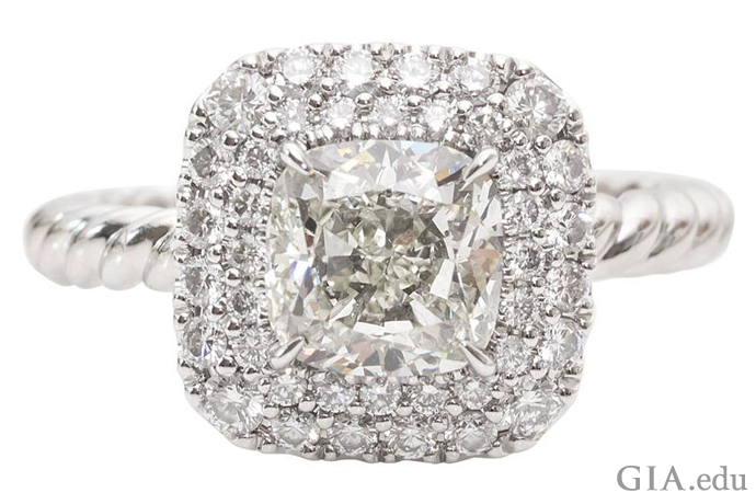 Diamond engagement ring with double halo setting surrounding a 1.17 carat cushion cut center stone.