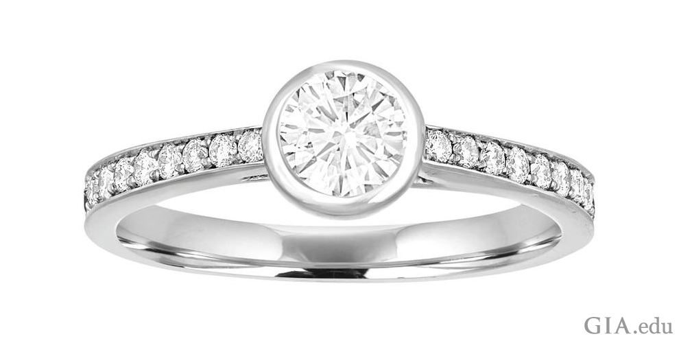 Diamond engagement ring with bezel settings.
