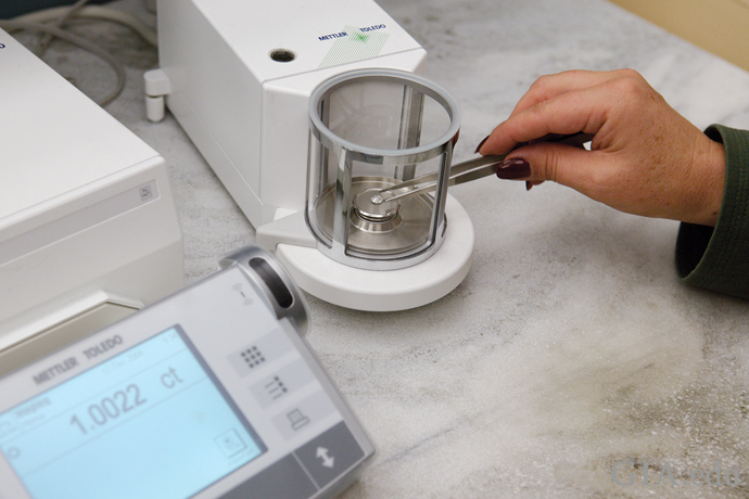 Diamonds being weighed on an electronic mirco-balance scale