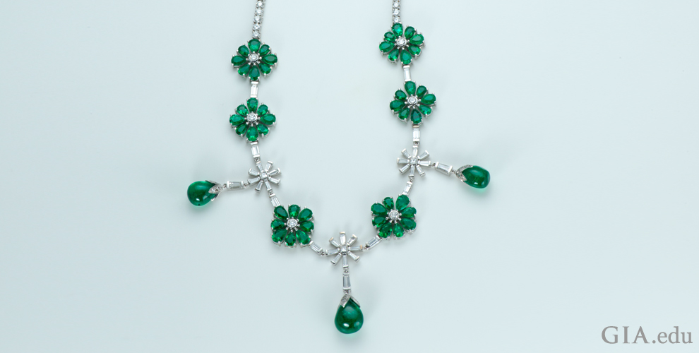 An emerald and diamond necklace totaling 41.97 carats