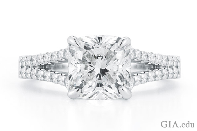 A 2.11 carat (ct) cushion cut diamond accented with 32 diamonds in the split shank
