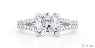A 14K white gold split-shank engagement ring with a 2.11 ct cushion cut center stone
