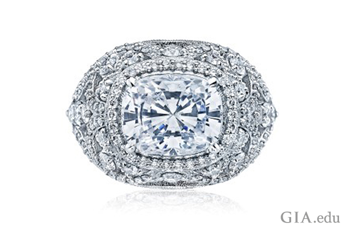 A cushion cut diamond engagement ring surrounded by an arrangement of small diamonds
