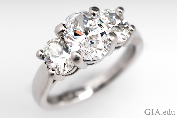 An oval diamond three stone engagement ring