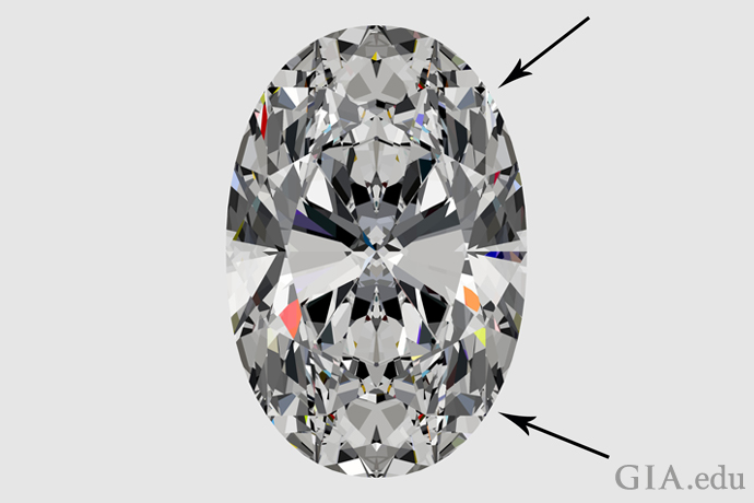 An oval diamond with bulging shoulders