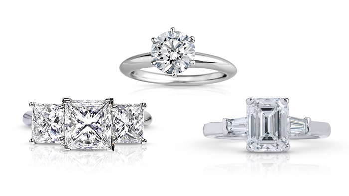 Three diamond engagement rings - princess cut three stone diamond ring, round brilliant solitaire diamond ring, and emerald cut diamond ring with tapered baguette sidestones.