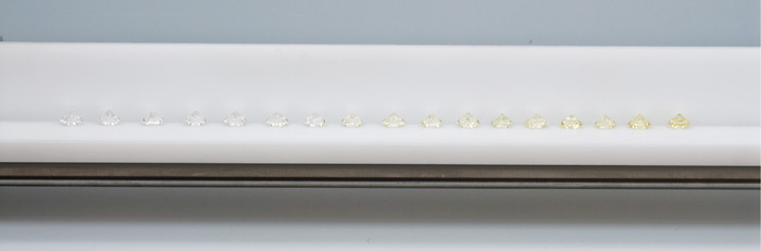 To provide a universal basis for diamond color comparison, GIA gemologists assembled a set of masterstones representing the color grades on the GIA scale. Each masterstone in the set represents a letter grade. The masterstones are positioned in left to right order in the grading tray, with their tables facing down.