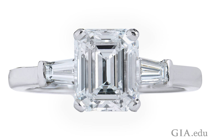 A 2.01 ct E-color emerald cut diamond flanked by two tapered baguette diamond accents