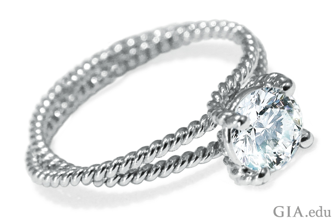 Round brilliant cut diamond engagement ring with platinum braided double shank.