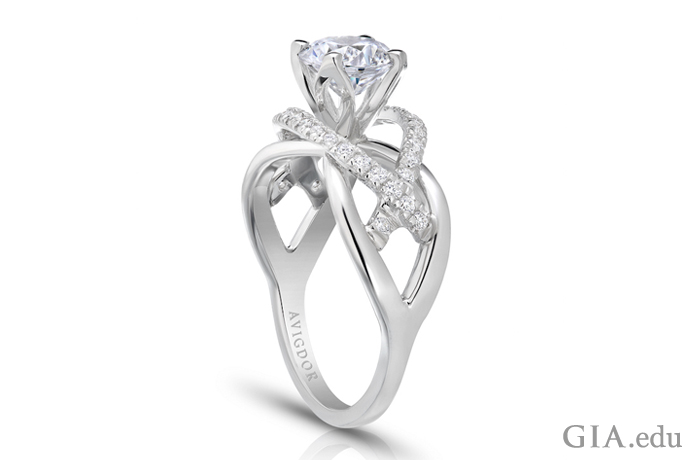 1.25 ct round brilliant cut diamond engagement ring with prong setting.