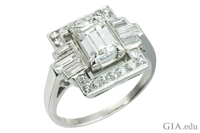 A 1.37 ct emerald cut Art Deco engagement ring accented with six baguette diamonds and 18 round brilliants
