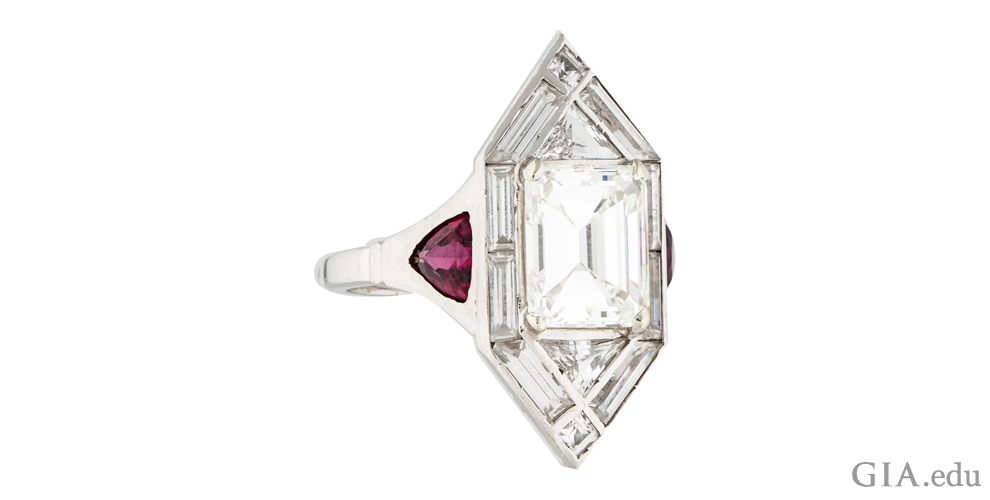 A 2.40 ct Art Deco engagement ring with 0.85 carats of baguettes, triangular diamonds and trilliant cut synthetic rubies
