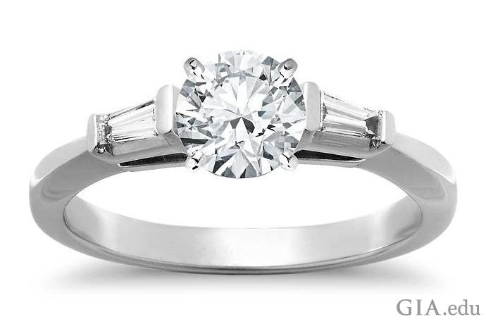 1.28 ct round brilliant cut diamond engagement ring with tapered baguettes.