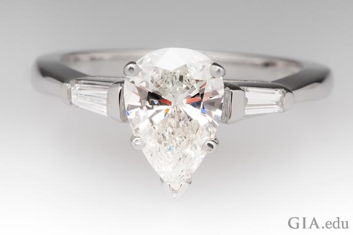 Pear-shaped diamond engagement ring.